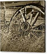 Sepia Toned Photo Of An Old Broken Wheel Of A Farm Wagon Canvas Print