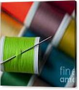 Sewing Needle With Bright Colored Spools Canvas Print