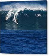 Sharing A Wave In Waimea Bay Canvas Print
