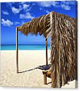 Shelter On A White Sandy Caribbean Beach With A Blue Sky And White Clouds Canvas Print