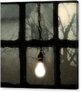 Lit Light Bulb Shines In Old Window Canvas Print