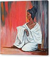 Sitting Lady In White Next To A Red Wall Canvas Print