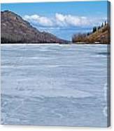 Skiing On Frozen Lake Laberge Yukon Canada Canvas Print