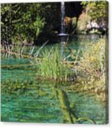 Small Waterfall And An Emerald Colored Lake Canvas Print