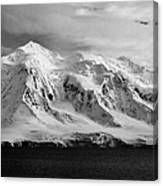 snow covered landscape of anvers island mountain range and neumayer channel Antarctica Canvas Print