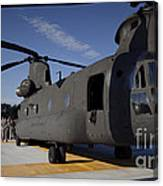 Soldiers Being Briefed Behind A Ch-47 Canvas Print