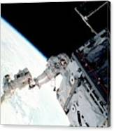Space Walk On The Iss Canvas Print