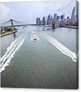 Speed Boats And Barge At East River In Front Of The Brooklyn Bridge And Manhattan Skyline Canvas Print
