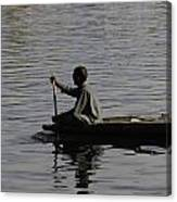 Splashing In The Water Caused Due To Kashmiri Man Rowing A Small Boat Canvas Print