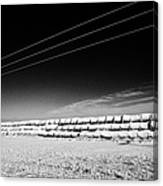 stack of frozen snow covered hay bales in a field Forget Saskatchewan Canada Canvas Print