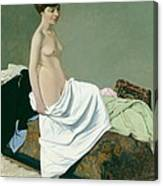 Standing Nude Holding A Gown On Her Knee Canvas Print