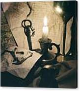 Still Life With Bones Rusty Key Wine Glass Lit Candle And Papers Canvas Print