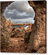 A Natural Stone Arch In North Coast Of Minorca Appears Like A Pass To One Thousand And One Night  Canvas Print