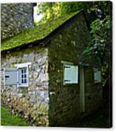 Stone House With Mossy Roof Canvas Print