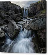 Stream Flows Over A Waterfall Canvas Print