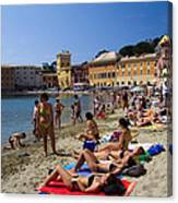 Sun Bathers In Sestri Levante In The Italian Riviera In Liguria Italy Canvas Print