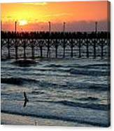 Sun Over Pier And Bird In Surf Canvas Print