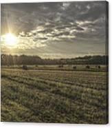 Sunrise Over Hayrolls Canvas Print