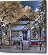The Decorated Little House In The Snow Canvas Print