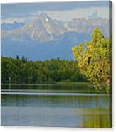 The Mountain Guards The River Canvas Print