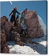 Three People Climb Down Rocks Canvas Print