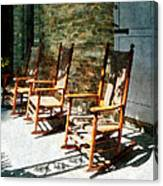 Three Wooden Rocking Chairs On Sunny Porch Canvas Print