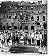 Tour Guide Explains To Group Of British Tourists About Gladiator Pits On The Floor Of The Arena Of The Old Roman Colloseum At El Jem Tunisia Vertical Canvas Print