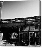 train going over railway bridge elevated section of track southwark London England UK Canvas Print
