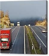 Trucks Driving Through A Misty Mountain Pass Canvas Print
