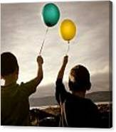 Two Children With Balloons Canvas Print