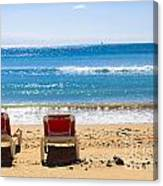 Two Empty Sun Loungers On Beach By Sea Canvas Print