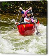 Two Paddlers In A Whitewater Canoe Making A Turn Canvas Print
