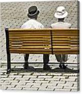 Two People Seated On A Bench Canvas Print