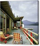 Two Women On The Deck Of A House On A Lake Canvas Print