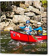 Two Women Paddling A Whitewater Canoe Canvas Print