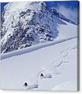 Two Young Men Skiing Untracked Powder Canvas Print