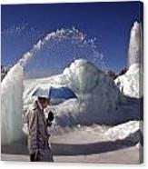 Umbrella Man At Frozen Fountain Canvas Print