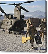 U.s. Army Sergeant Helps Unload Band Canvas Print