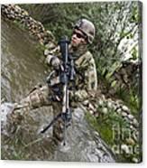 U.s. Army Soldier Walks Through A Creek Canvas Print