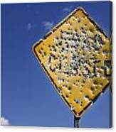 Vandalized Road Sign Many Bullet Holes Canvas Print