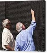 Veterans Look For A Fallen Soldier's Name On The Vietnam War Memorial Wall Canvas Print