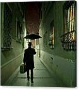 Victorian Man With Top Hat Carrying A Suitcase And Umbrella Walking In The Narrow Street At Night Canvas Print