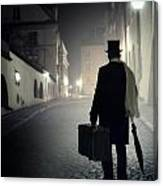 Victorian Man With Top Hat Carrying A Suitcase Walking In The Old Town At Night Canvas Print