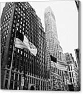 view of pennsylvania bldg nelson tower and US flags flying on 34th street new york city Canvas Print