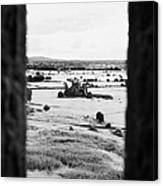 viewpoint looking out through stone fortifications towards hore abbey from the Rock of Cashe Canvas Print