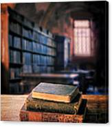 Vintage Books And Glasses In An Old Library Canvas Print