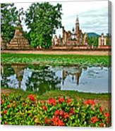 Wat Mahathat Reflection In 13th Century Sukhothai Historical Park-thailand Canvas Print