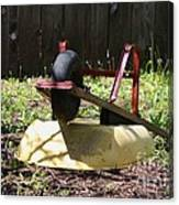 Wheel Barrow In A Yard Canvas Print