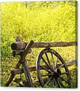 Wheel On Fence Canvas Print