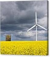 Windmill With Motion Blur In Rapeseed Field Canvas Print